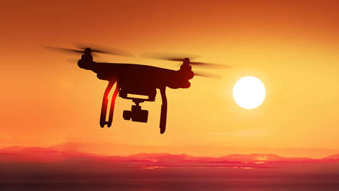 Quadcopter Flying Far Away to the Beautiful Sunset Sun.... Stock Video Footage