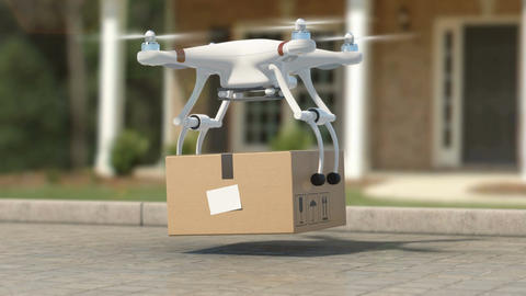 Quadcopter Picking Up a Package from the Ground. Taking... Stock Video Footage