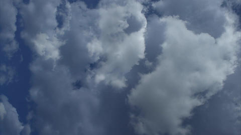 Clouds Roll Across Blue Sky Time Lapse Footage