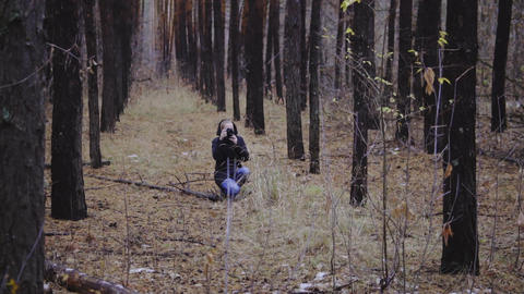 photographer girl taking pictures of autumn forest. first snow. takes pictures Footage