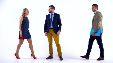 Group of three business partners posing in studio for camera. Slow motion Footage