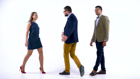 Group of three business partners posing in studio for camera Footage