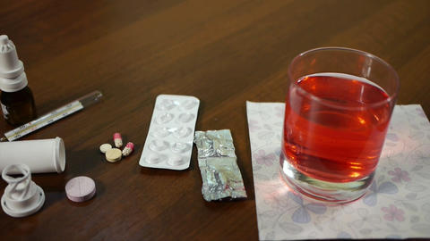 pills and thermometer on the table Live Action