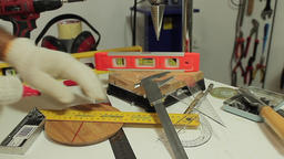 The worker is measuring with liners and tools in the workshop Footage