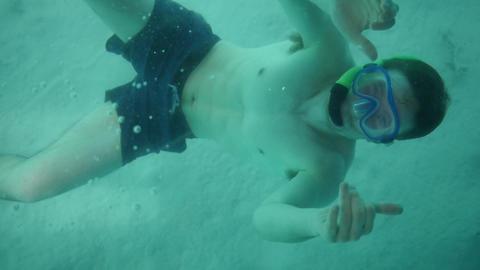 Snorkeling Man Thumbs Up Underwater Footage