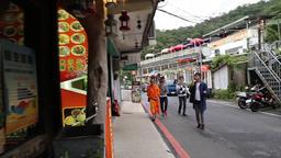 Tourists eating ice cream in the tea mountain village of Maokong Taipei Taiwan Image