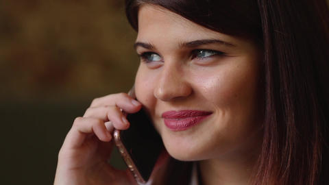 Beautiful business woman talking on the phone smiling and... Stock Video Footage