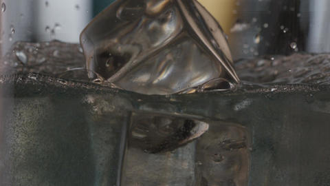 Pouring Water Over Ice Cubes Footage