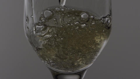 Champagne Filling Glass Closeup Footage
