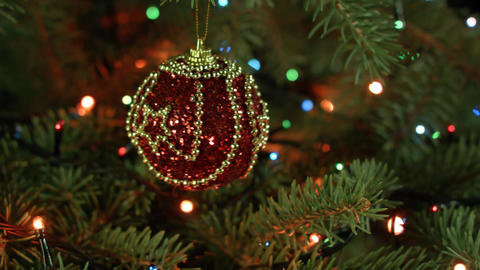 Christmas ornaments on the Christmas tree beautiful red ball with lights Footage