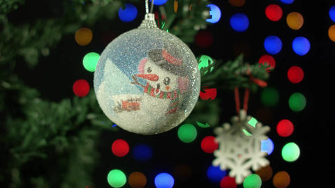Christmas ornament on a Christmas tree ball on background with blurry lights Footage