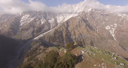 Zooming Away from Rocky Snow-Capped Mountains Footage