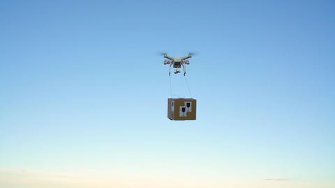 Drone delivering package on the sky background Footage