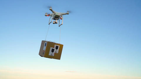 Drone delivering package on the sky background. Slow motion Footage