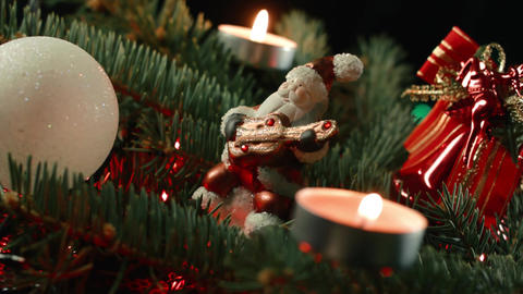 figurine Santa with decorated Christmas tree balls and candles Footage
