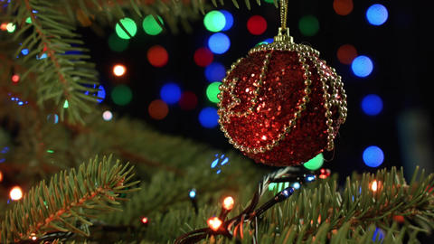 Decorated Christmas tree on blurred, sparkling and fairy background, beautiful Footage