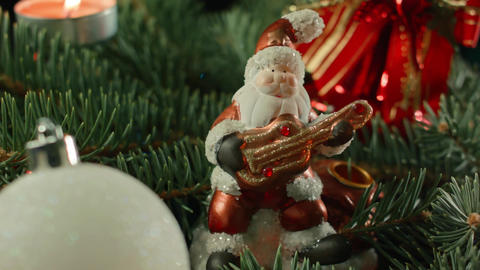 toy Santa on the Christmas tree with balls, candles and garland Footage
