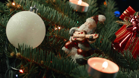 Santa on the Christmas tree with Christmas balls with candle and garland Footage