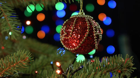 beautiful red ball with garland on the Christmas tree on Christmas night Footage