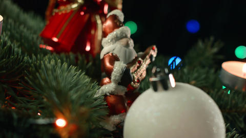 Santa with Christmas toys on the background of blurred lights garlands Footage