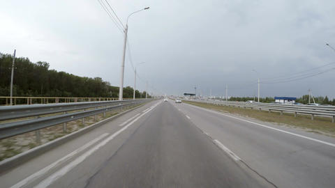 The car is driving along the highway. Rear view Footage