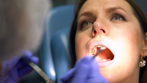 Closeup woman getting a dental treatment Footage