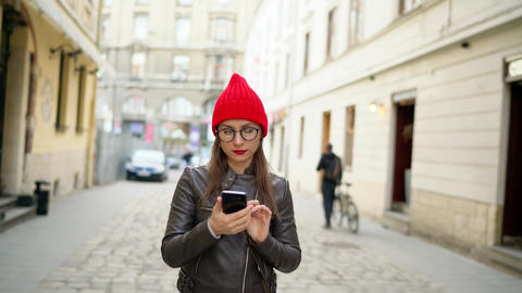 Woman makes photos attractions of the old city by the smartphone and strolls Footage