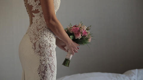 Wedding, bride in a lace dress hold a bouquet Live Action