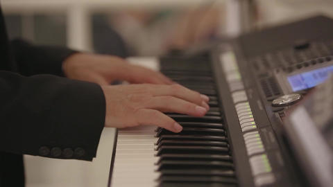 A man plays an electronic piano at a wedding Footage