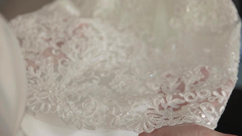 Wedding, the bride's hands touch the lace on the dress Footage