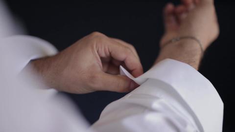 Wedding, groom putting on his cufflinks Footage