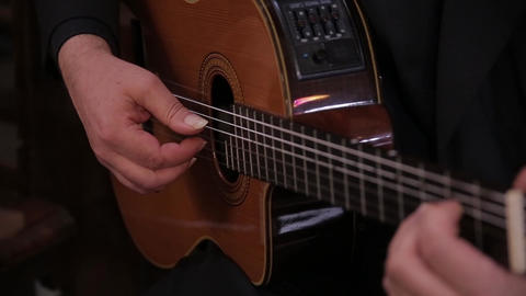 Man hand guitar strings strummed Footage