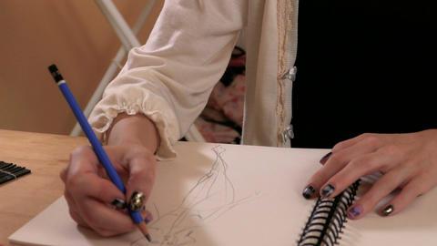 Fashion designer sketching CU hands Footage