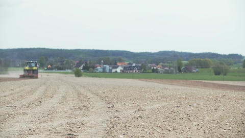 Tractor plowing field. AGRICULTURE Archivo