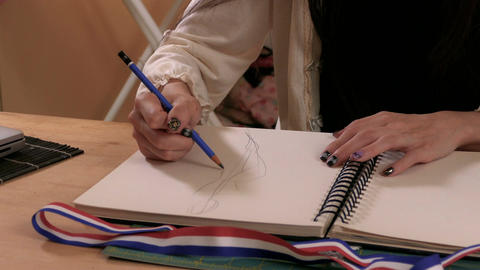 Fashion designer sketching 画像
