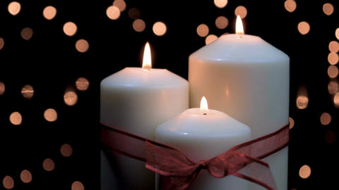 Christmas candles burning in atmospheric light Footage