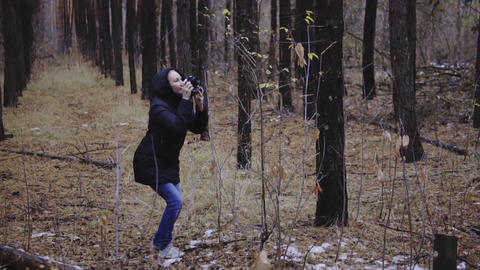 Woman photographer takes pictures outdoors Footage