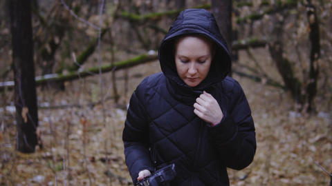 slow motion, cinematic shot. the girl is walking in the autumn forest with a Footage