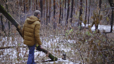 the guy walks through the woods and smokes. autumn forest, the first fallen snow Footage