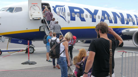 OSLO - NORWAY, AUGUST 2015: people taking plane, climbing stairs Footage