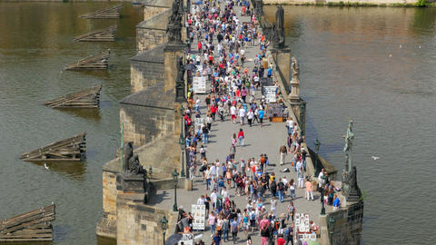 PRAGUE - CZECH REPUBLIC, AUGUST 2015: people crossing bridge castle Footage