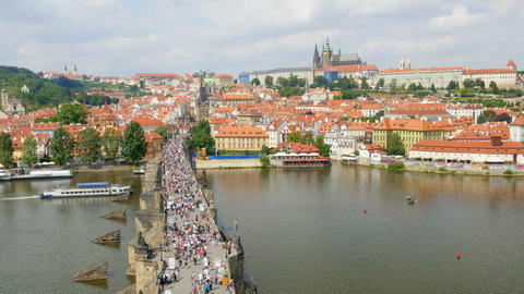 prague castle view, people walking crossing charles bridge, czech republic Footage