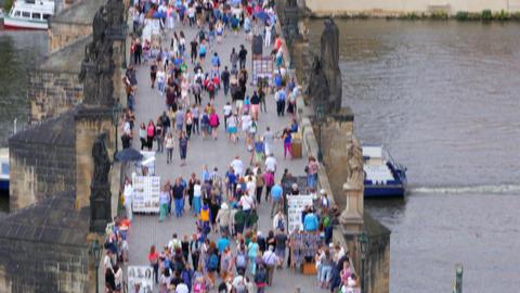 PRAGUE - CZECH REPUBLIC, AUGUST 2015: people crossing bridge castle Footage