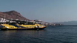 Turkey the Aegean Sea Turgutreis 083 hydrofoil ferry boat leaves city Footage