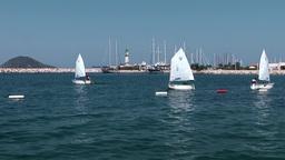 Turkey the Aegean Sea Turgutreis 091 sailing school and lighhouse Footage
