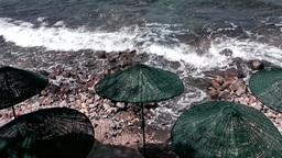 Turkey the Aegean Sea Turgutreis 039 rough shore and straw sun shades Footage