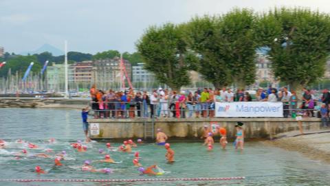 GENEVA - SWITZERLAND, AUGUST 2015: public swimming competition on lake Footage