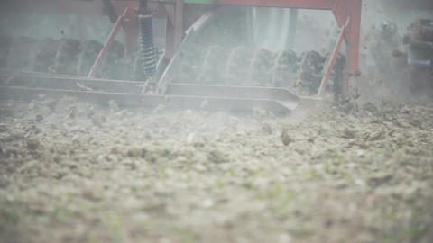 FARMING, Agriculture - Farmer sowing field Footage