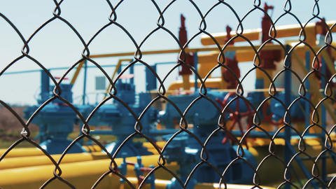 Oil and gas plant. Pumping station behind the fence in the defocus. Fence mesh Footage