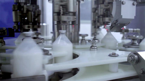 Robotized Machine packaging Bottles Stock Video Footage